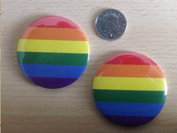 Large Gay Pride Rainbow Badges versus 10p size