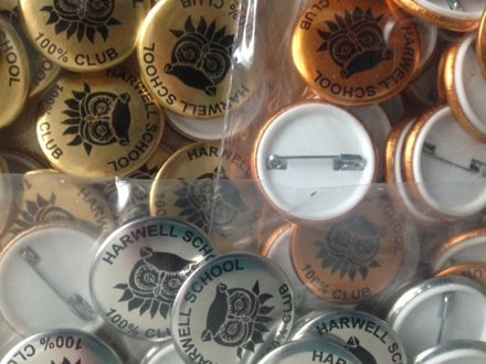 Metallic finish button badges